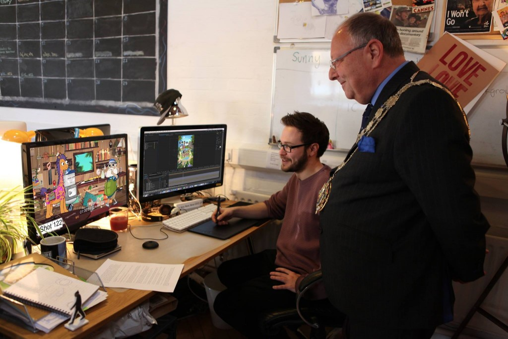 LoveLove lead animator Sunny Clarke showing the Mayor of Bournemouth our latest project, Bottle Island