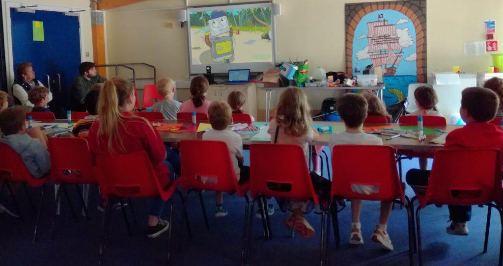 Children watching the Bottle Island Pilot Episode 'Crab City'